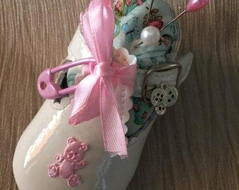 Cute pink baby shoe pink cushion