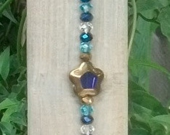 X mas tree ornament /  Crystal sun catcher with long glass beads and a star shaped bead in the center / Bead sun catcher