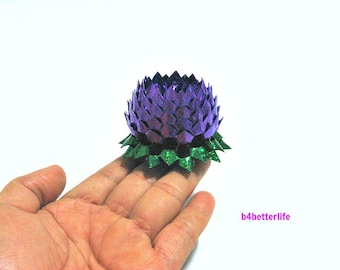 A piece of Small Size Purple Color Hand-folded Origami Lotus. (4D Glittering paper series).