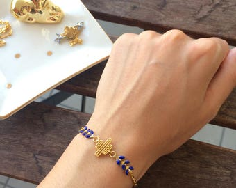 Bracelet gold cactus and dark blue ear chain