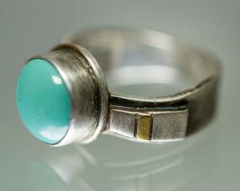 Turquoise sterling silver ring with gold and silver little bits