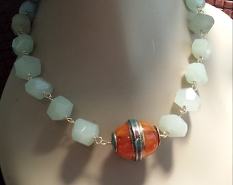 One strand greenish blue faceted stone necklace with center piece