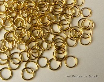 100 rings open 8mm gold tone metal. epais.0.8