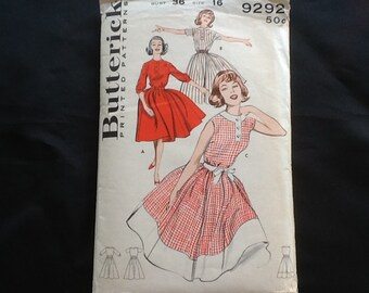 Butterick pattern 9292. Vintage 1960 misses' polo neck dress with full gathered skirt, sleeve variations, optional border trim. Size 16.