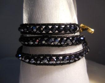 Wrap bracelet triple row beaded with blueblack rondelles