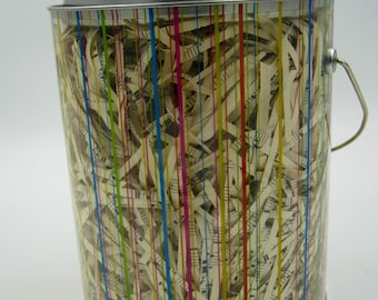 Clear Paint Bucket Filled with Music Shreds, great for packaging