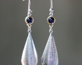 Silver leaf shape earrings with textured and tiny Iolite in brass bezel setting on oxidized sterling silver hooks style
