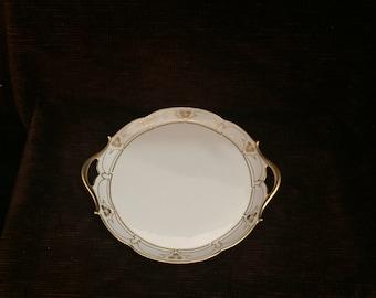 T & V Limoges gold trimmed serving dish with handles