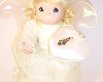 Precious Moments August Birthstone Angel Doll comes with stand.
