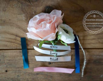 Pink rose and white ranunculus boutonniere