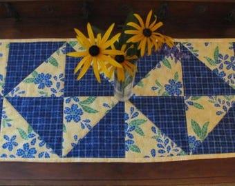 Bright yellow/blue Mosaic and blue pinwheel table runner