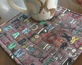 Back-to-school mug rug for teacher.Reversible, vintage buttons in corners.