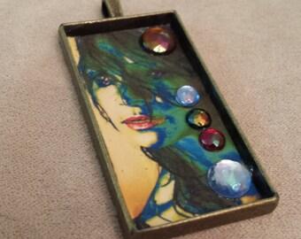 pendant original hand made 1 inch x 2 inch mystery woman portrait modern abstract blue green crystals brass rectangular