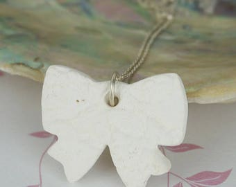 White Unglazed Ceramic Bow Lace Imprint Necklace on Sterling Silver Chain