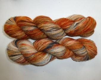 Hand dyed alpaca in rust/dark grey/golden/mint