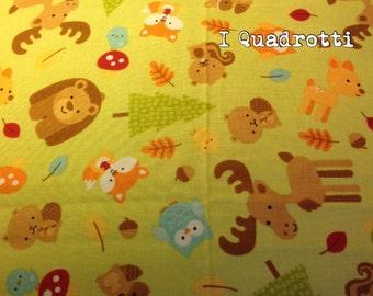 Green quilt with bears, reindeer, owls, raccoons