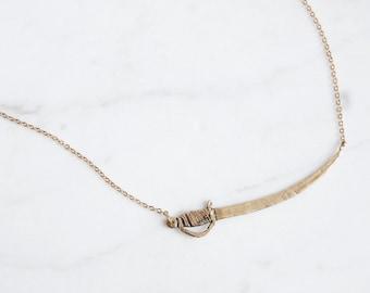 Golden sword necklace