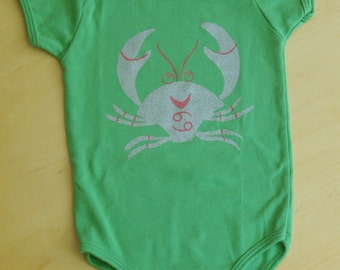 Silver and Pink Cancer Crab on Green Onesie