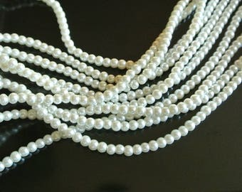 Set of 50 small round and smooth creamy white glass pearls 4 mm in diameter, hole: 1 mm