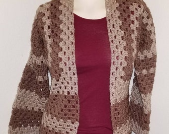 Neutral Granny style cardigan sweater with long sleeves.