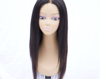 16 Inch layered 100% virgin hair wig hand sewn on dome cap. Lace closure.