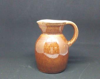 Handmade old varnished individual french stoneware jug