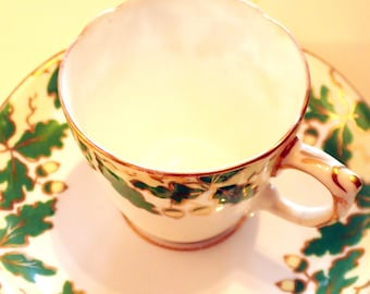 Teacup and Saucer Set with green acorn and gilt pattern
