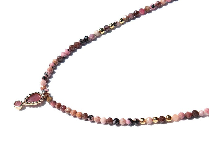 rhodonite gems and a pendant necklace