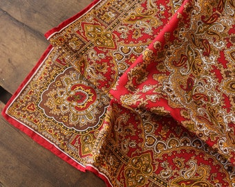 Hand-rolled vintage silk scarf with paisley print in red, gold, brown, tan, yellow and black