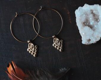 zahira. a pair of minimal bohemian brass floral hoop earrings.