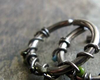 entwined septum ring-- 16g niobium hoop-- handmade by thebeadedlily