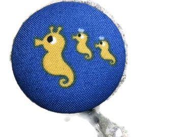 Whimsical badge button holder  yellow sea horse design