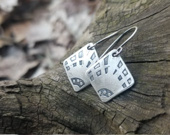Handmade Sterling Silver etched earrings.