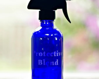 Protective Blend- Etched Blue GLASS 16oz spray bottle. Ideal for use with protective blend essential oils of any brand.