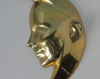 1980s  Brass Half Moon Face wall hanging.