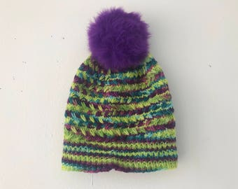 Lime green and purple wacky hat with purple floof