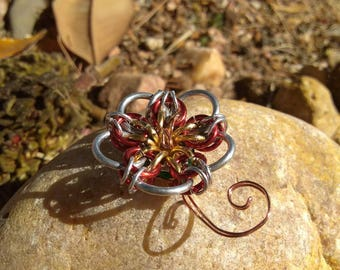Silver, red, and gold flower pendant