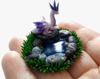 White tiny dragon by a pond