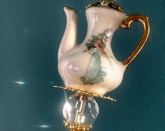 Tea Pot Hat Pin with a Angel with gold china paint and clear glass beads