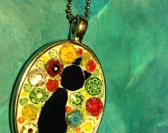 Mosaic right facing black cat oval pendant with millefiori background