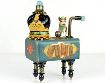 assemblage art, mixed media,dog, porcelain,vintage tin, ceramic,found object, teal blue, gold, biscuit, one of a kind, original artwork