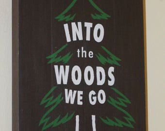 Into the woods we go wooden sign