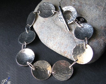 Sterling silver disc bracelet with toggle clasp.  Hammered shiny coins.  Classic handmade jewelry for her.  Womens gift.
