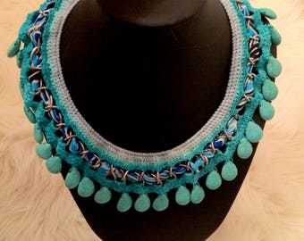 The beach of blowers. Crocheted blue necklace