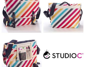 NWT, Messenger Bag the Tutti Collection from Studio C, White with Colorful Stripes Laptop Bag.