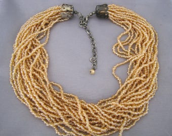 Vintage Gunmetal Soft Peach Seed Bead 19 Strand Necklace.
