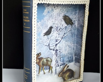 Handmade mixed media art old book cover winter scene with animals shadowbox