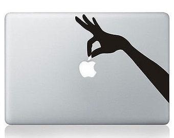 Sticker MacBook hand catches Apple