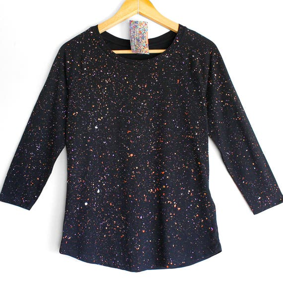FIREFLIES. Black womens top with colour splash pattern. Hand painted. Womens 3/4 sleeve organic cotton and tencel top.
