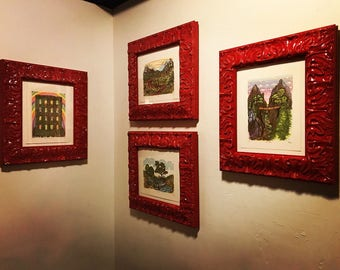 Four Prints in Bright Red Ornate Frames